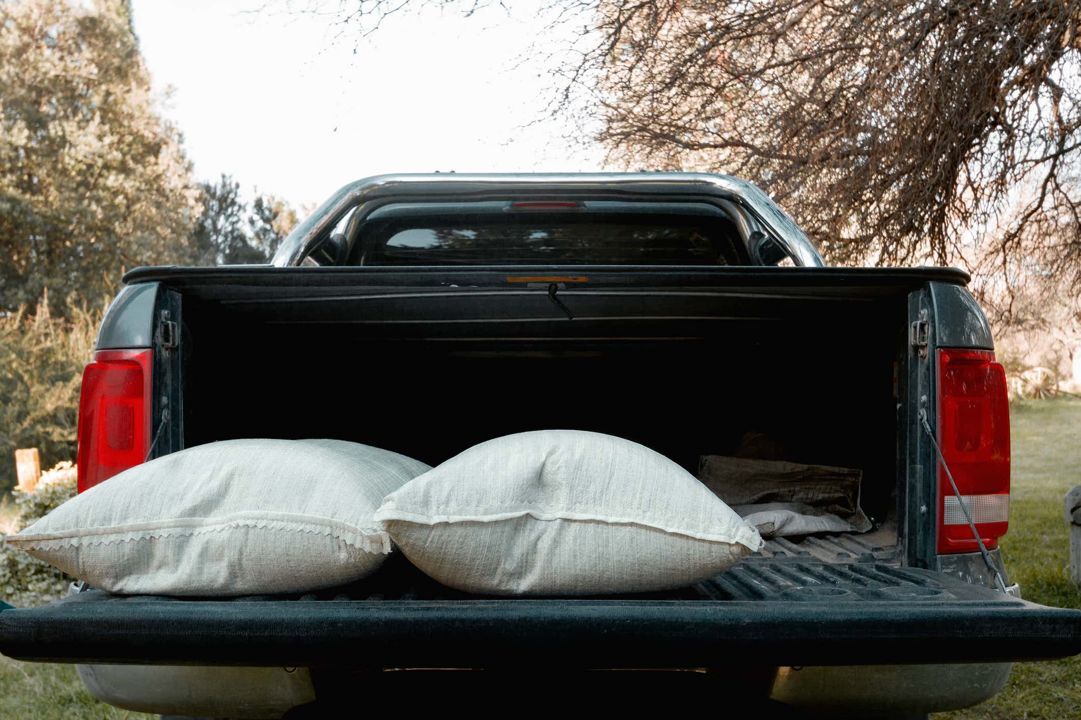 Back of pick up truck with open cab and sandbags