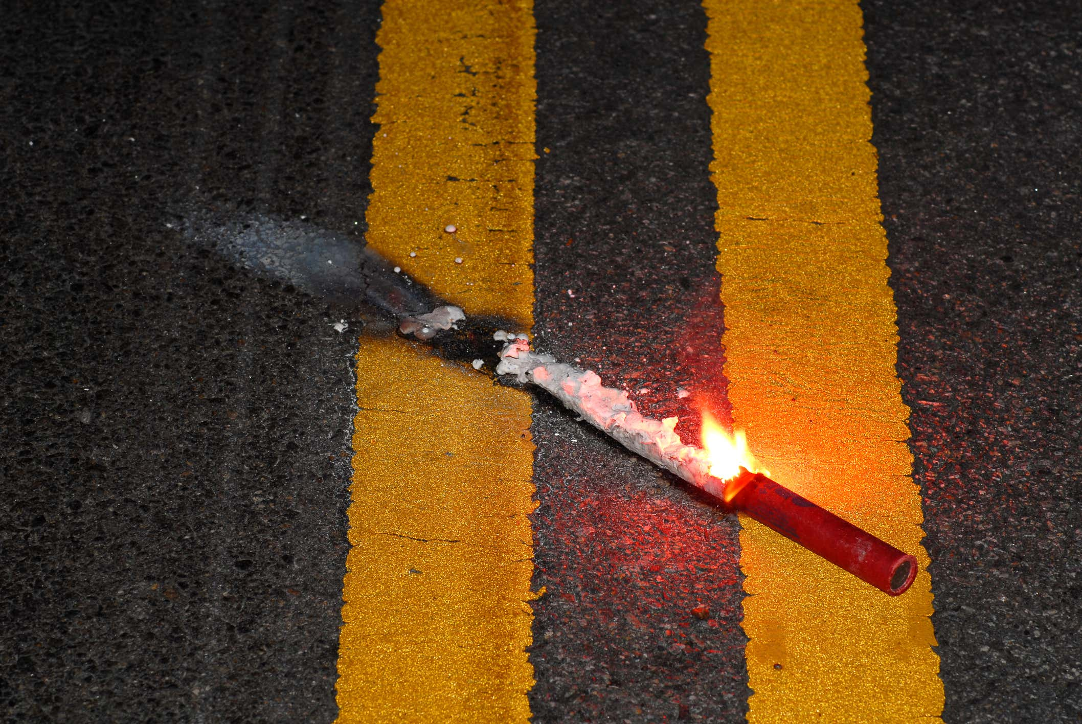 Close up road flare on pavement