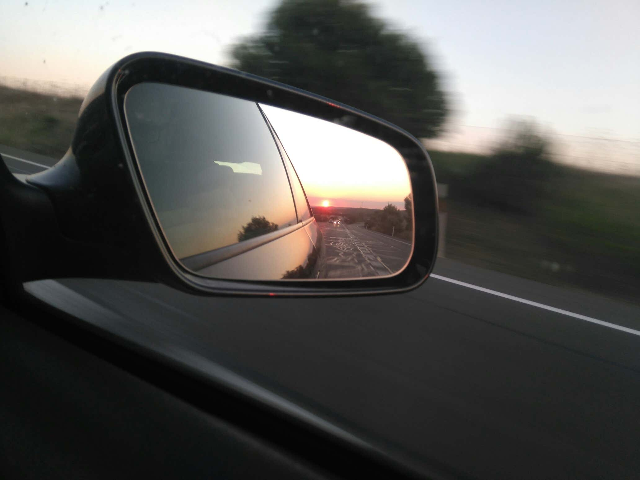 Close up of side mirror on highway