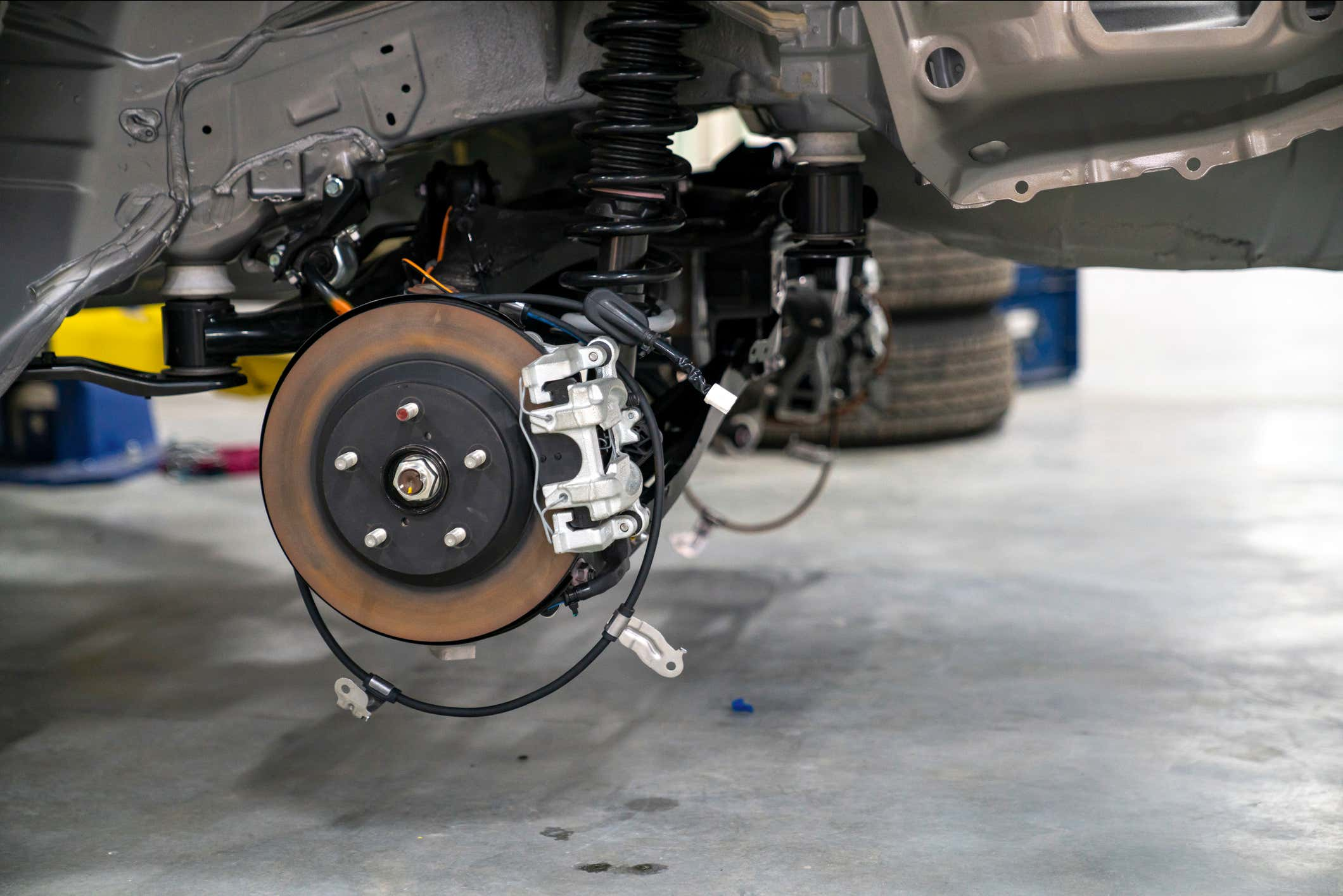 Close up of a brake disc in a car during maintenance.