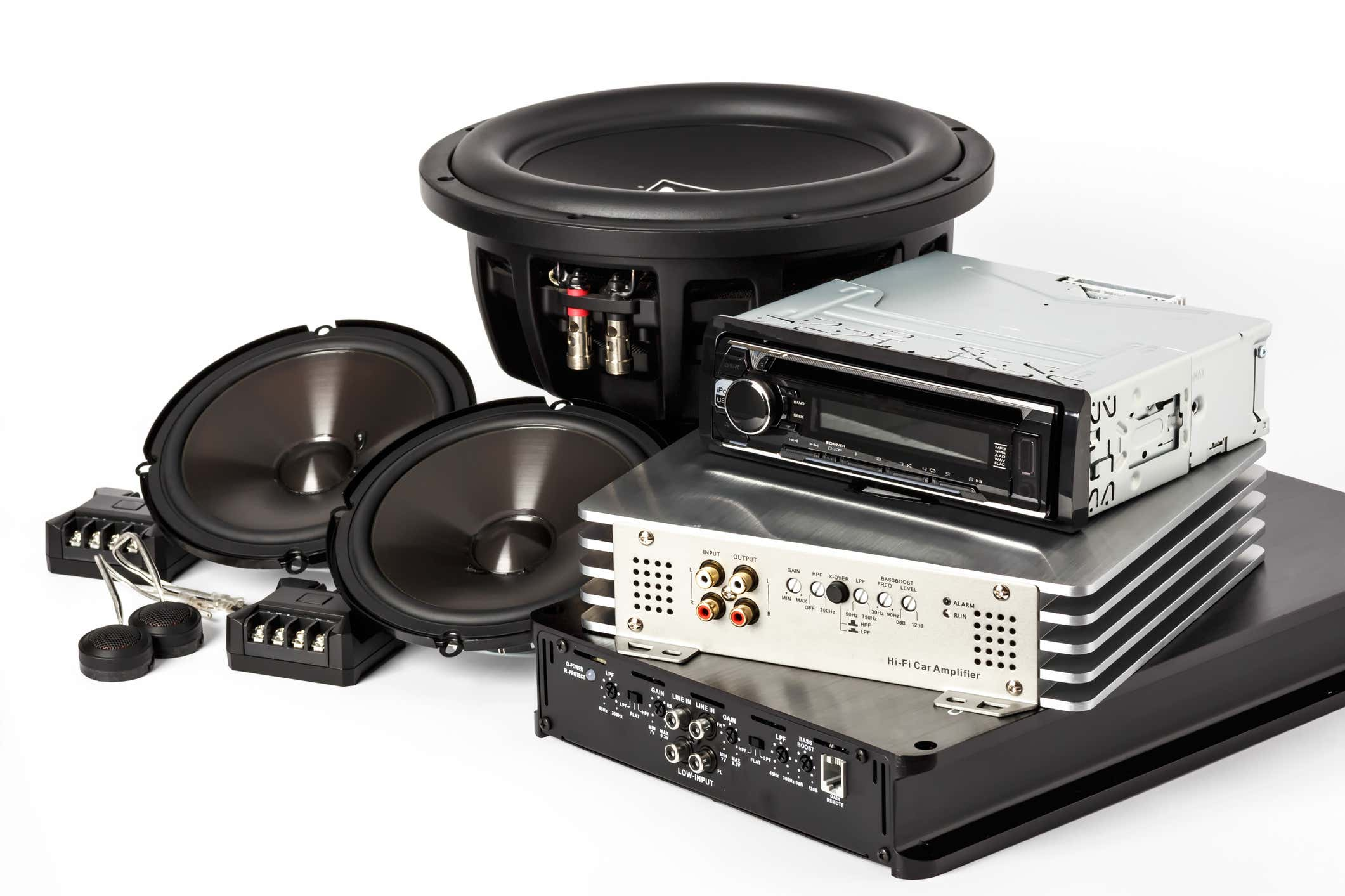 A collection with a car stereo and speakers.