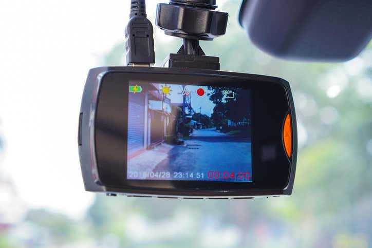A dash cam showing a back alleyway.