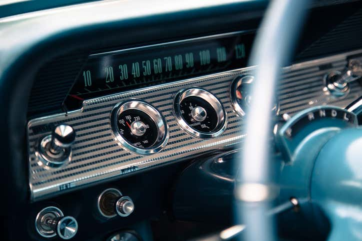 The dashboard of a classic car.