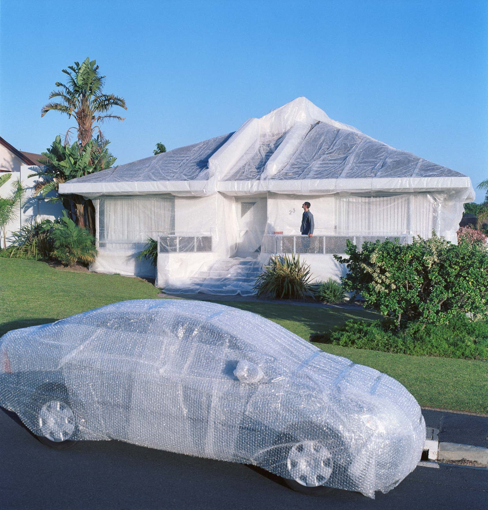 Bubble wrapped car and house.