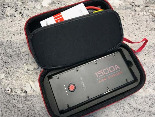 A jump starter and accessories in a soft case.