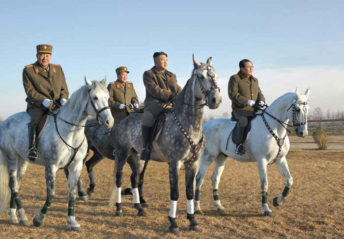 A younger Kim riding with his inner circle—some of which have since gotten the axe—during a military inspection. Image circa 2012.