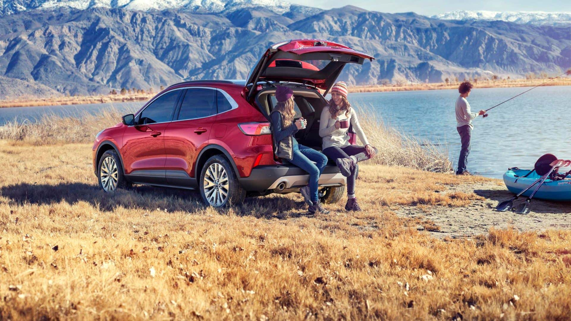 A small encampment with a new Ford Escape.
