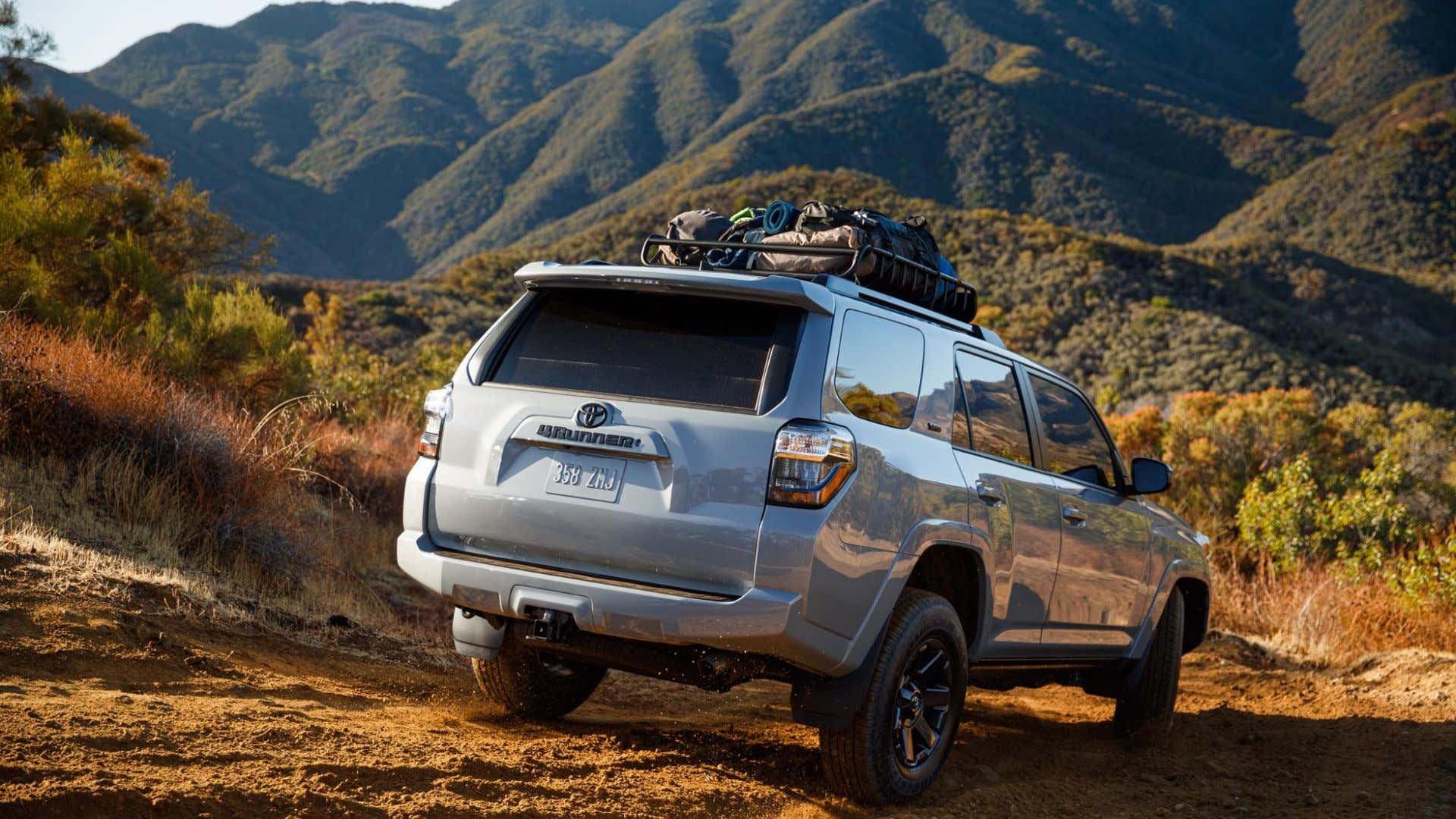 A Toyota 4Runner off-roading to a camp site.