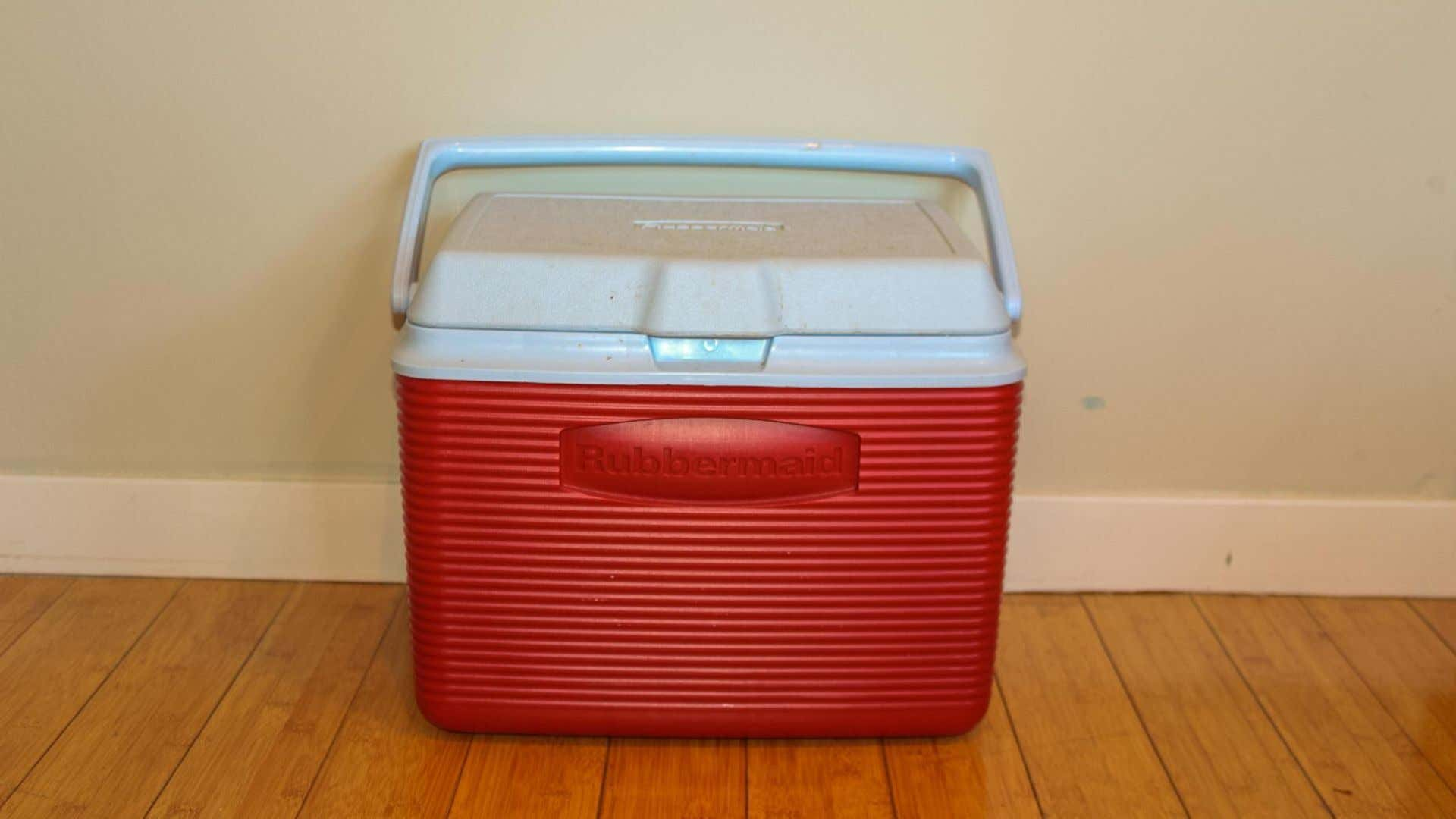 A red rubbermaid cooler.