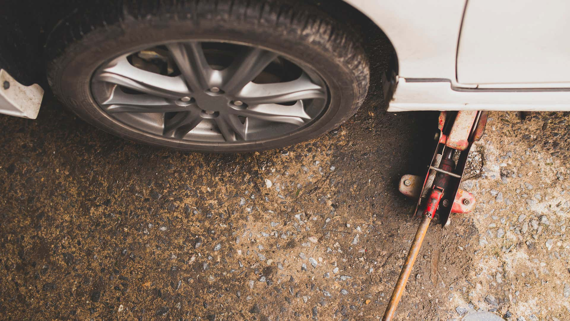 A heavy duty jack is crucial for rotating tires.
