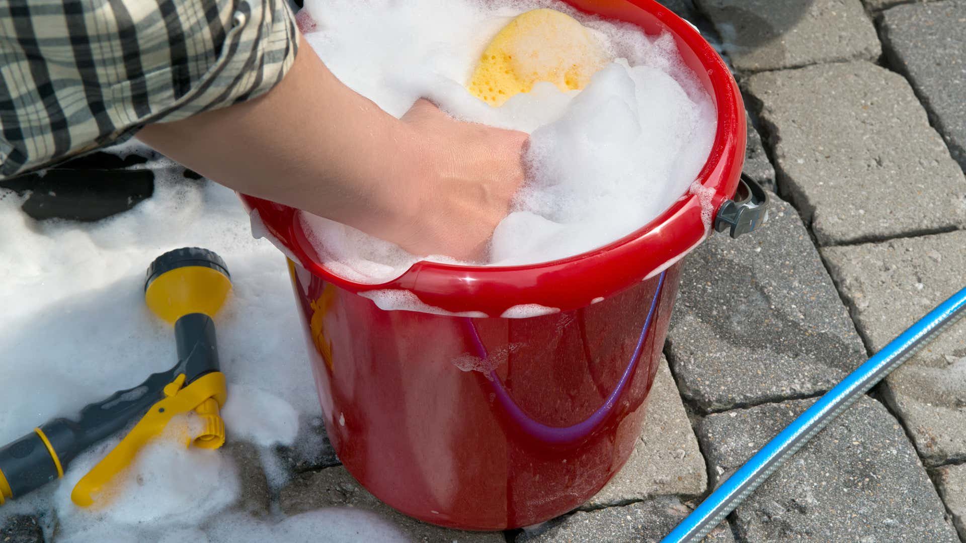 Use a two-bucket system when washing a car.