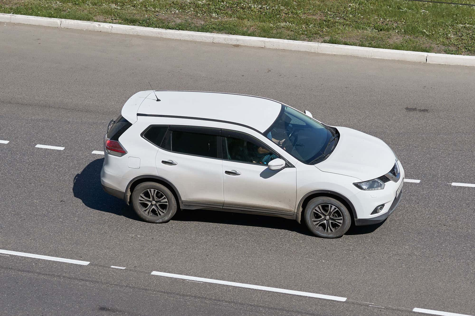 White Nissan Rogue on the street