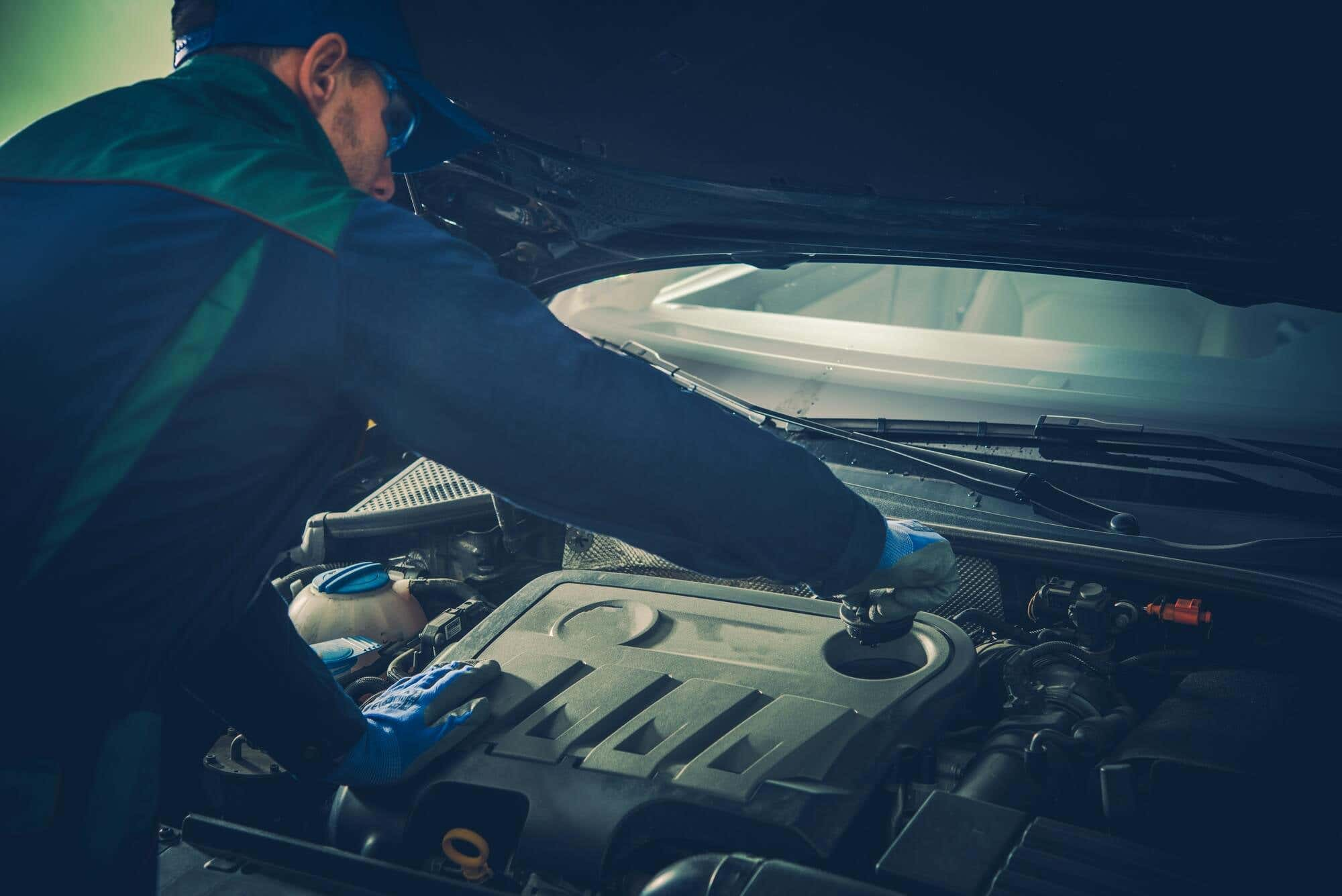 Vehicle Fluids Maintenance by Professional Car Mechanic