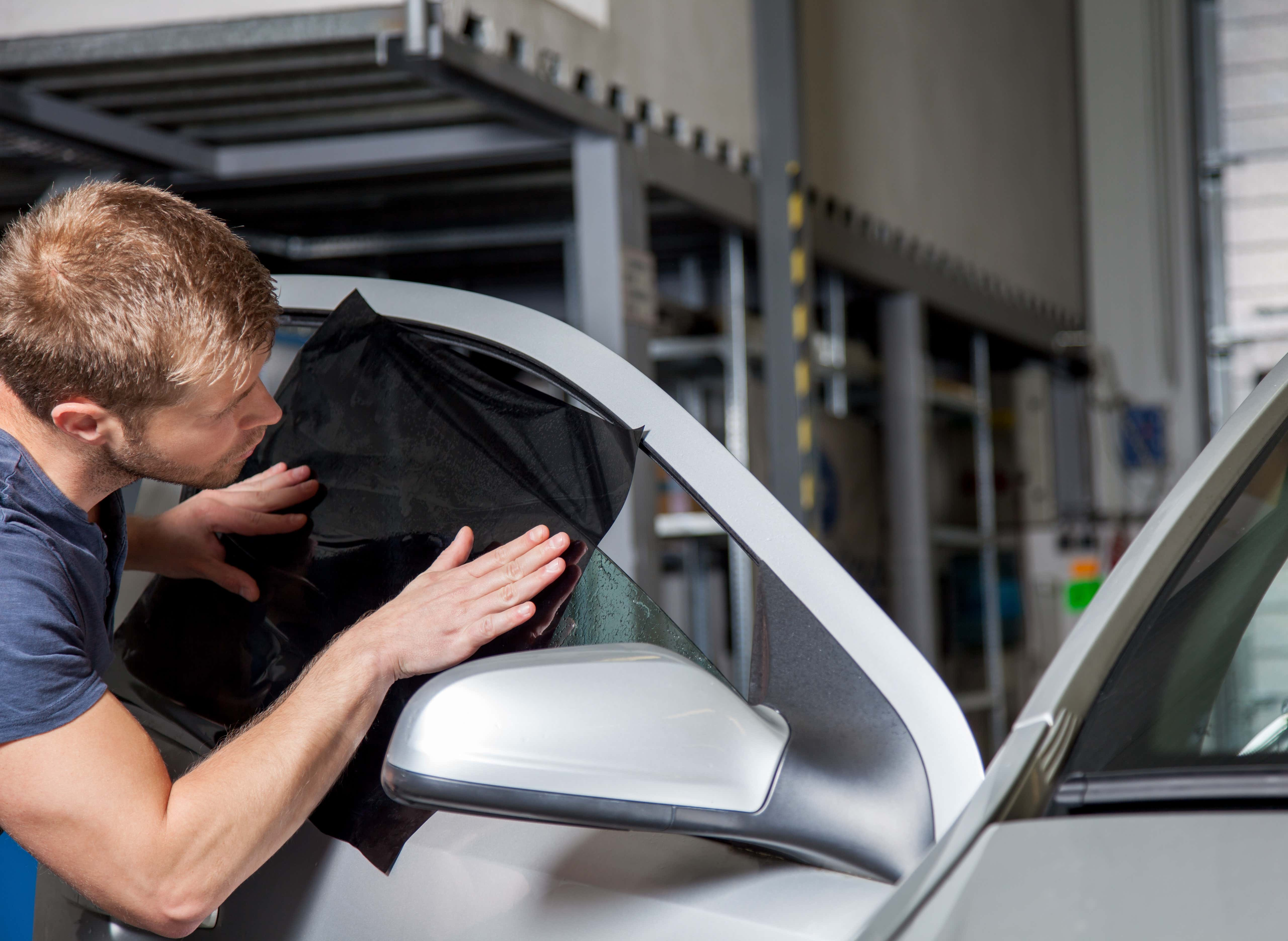 Window tinting isn't complicated, but requires a steady hand.