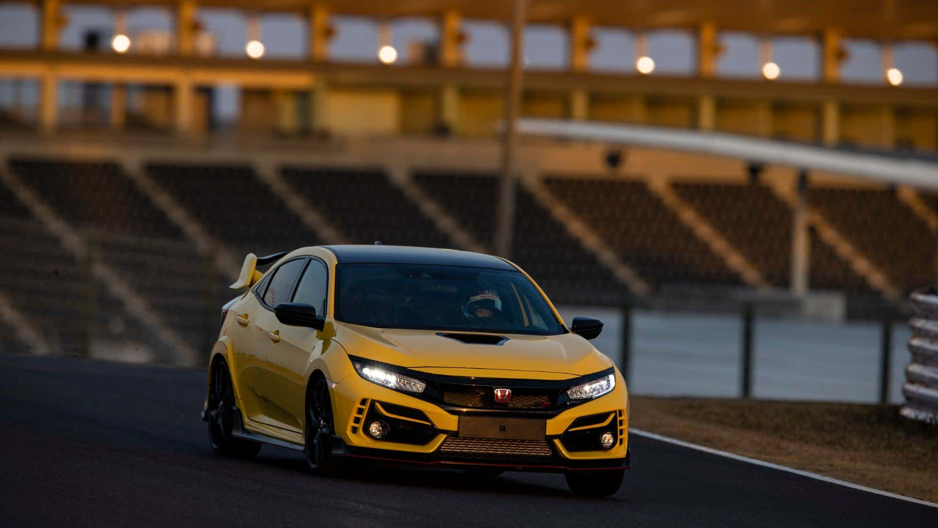 A Honda Civic Type R wears its Phoenix Yellow proudly.