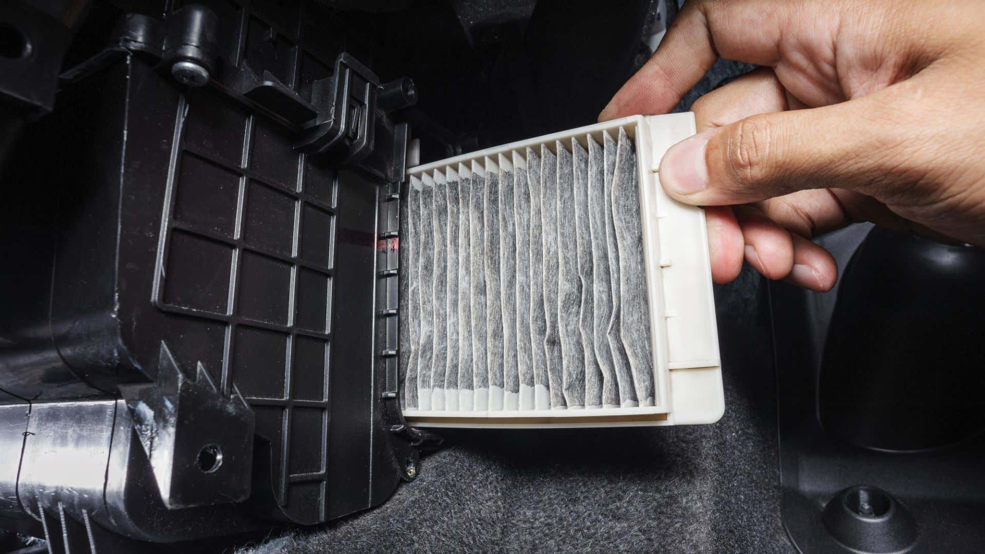 A cabin air filter being removed.