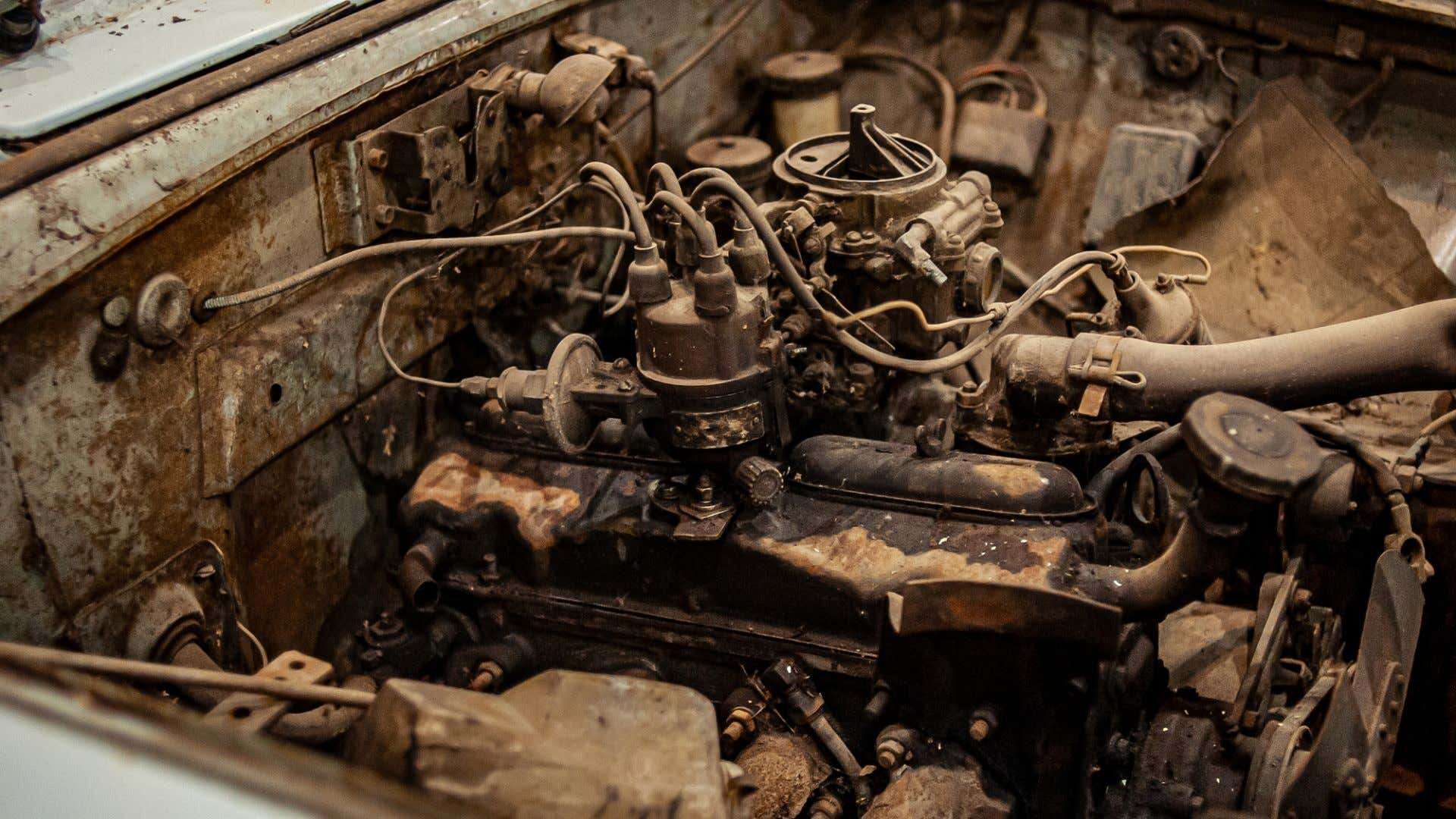 A very dirty, rusting engine.