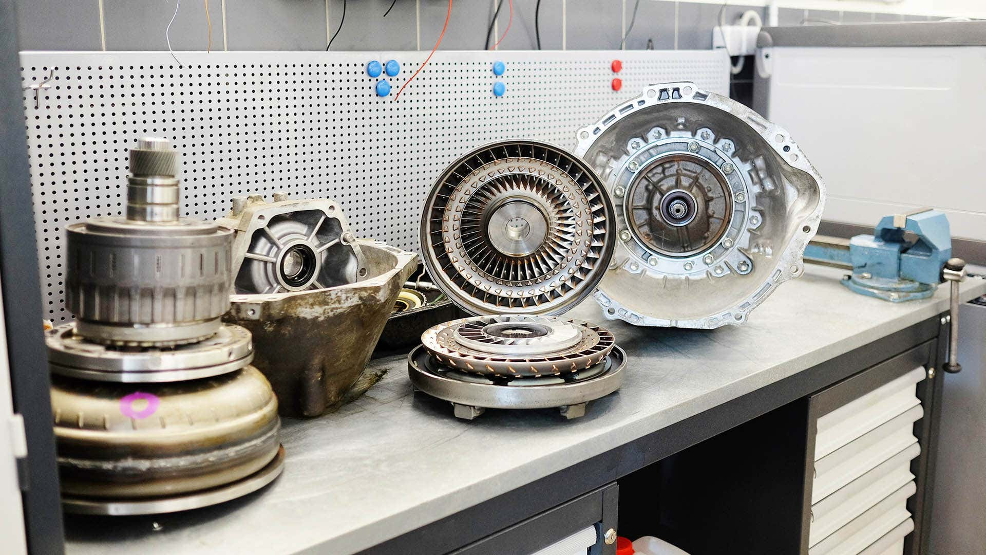 An automatic transmission taken apart to show the inside of a torque converter.