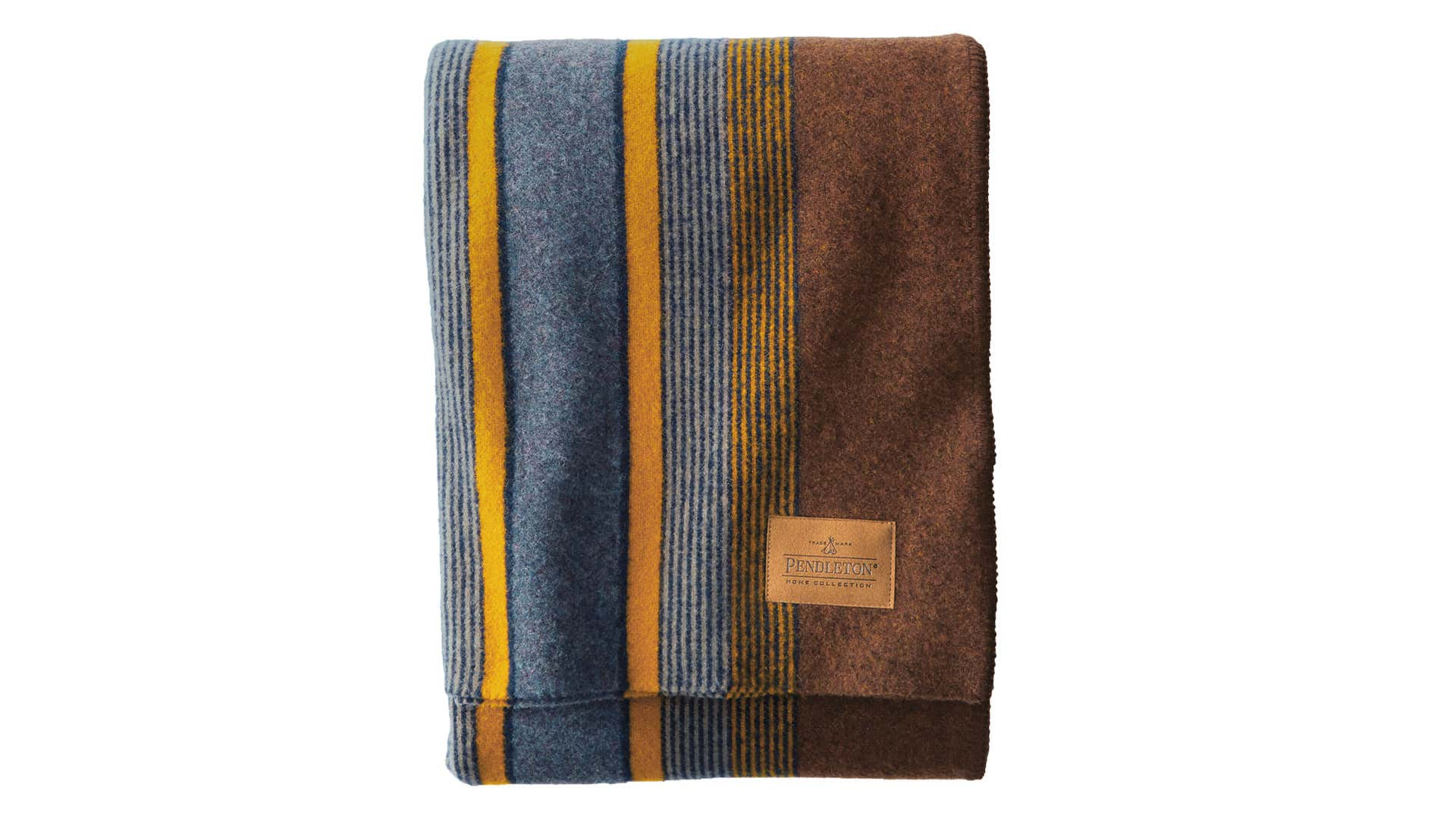 A striped Pendleton wool blanket is folded into a small rectangle.
