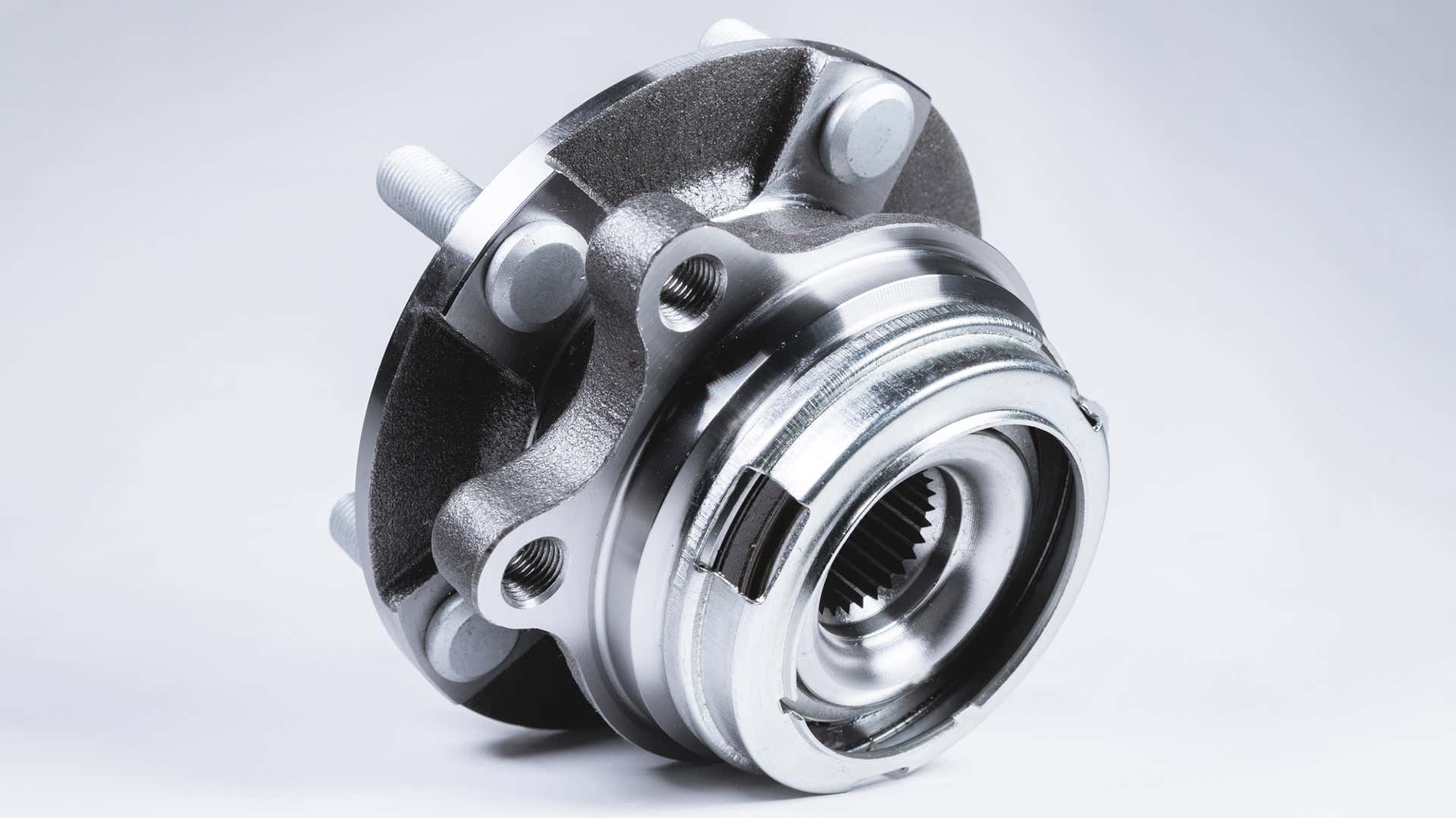 A wheel hub assembly on a gray background.