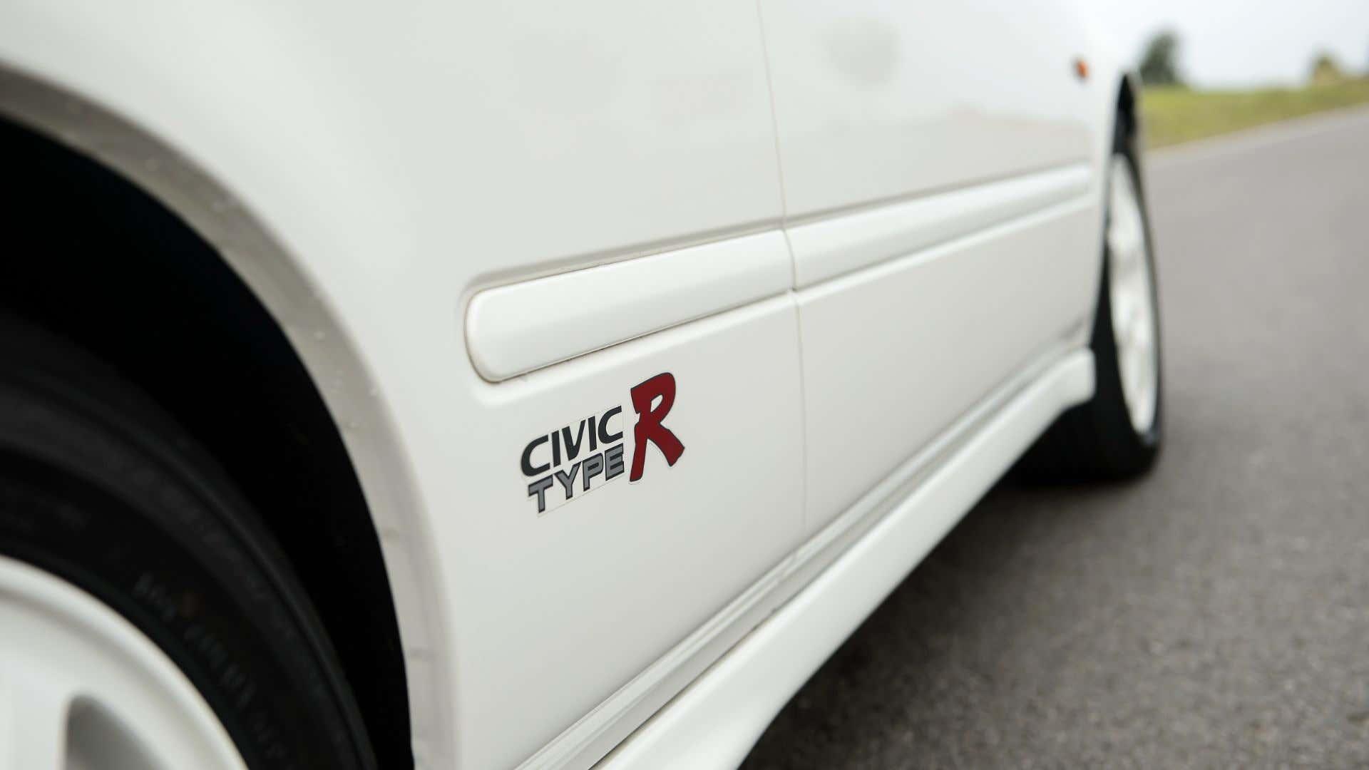 A Civic Type R logo.