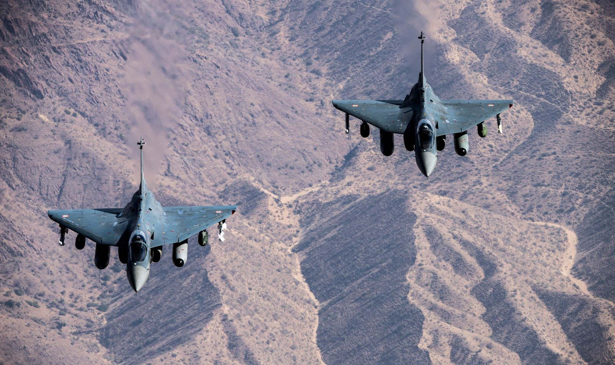 A pair of Tejas Light Combat Aircraft in formation. Progress on signing off on orders for the Tejas has been slow and there remain question marks over its capabilities and growth potential.
