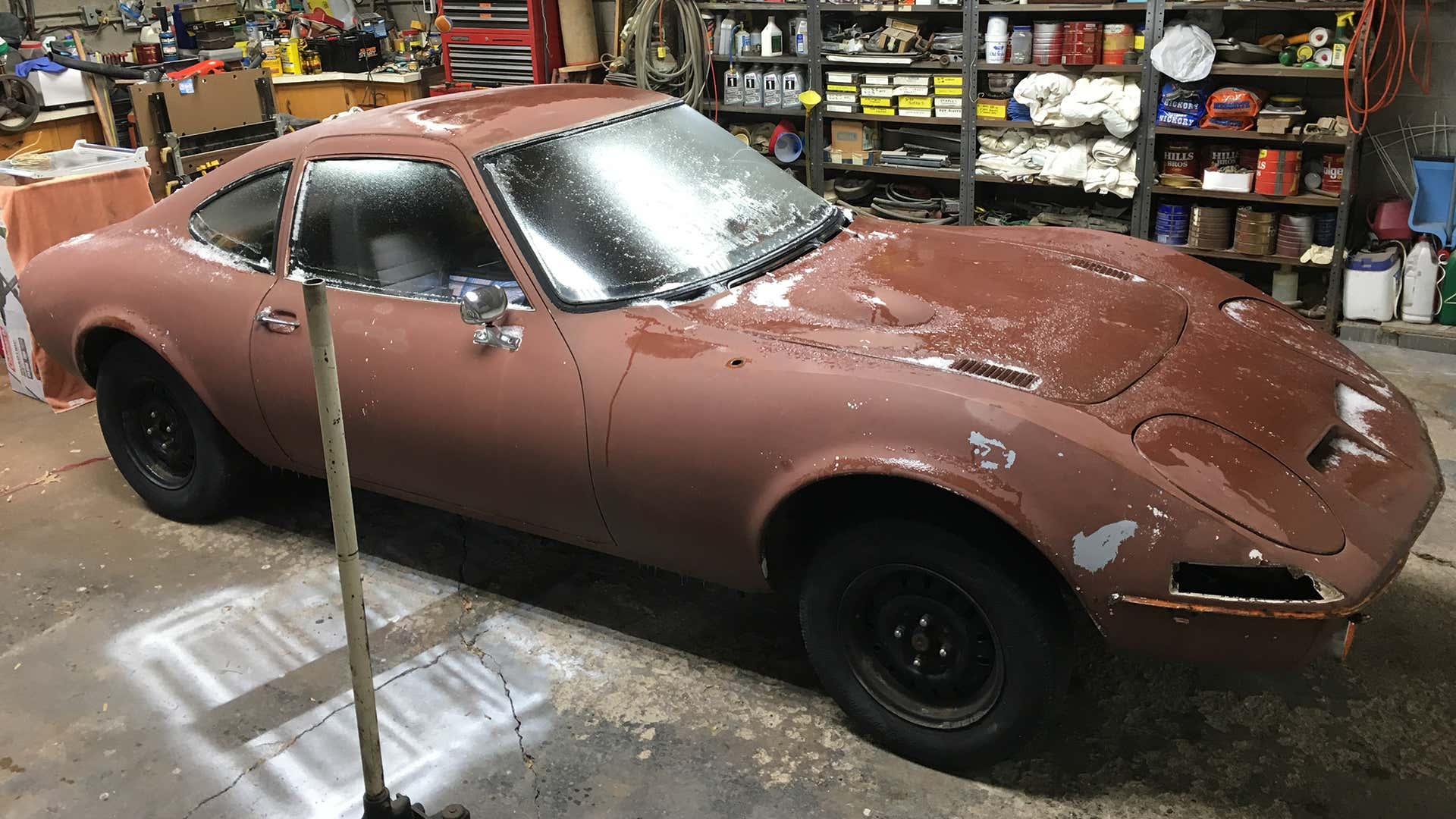 An Opel GT project in a garage.