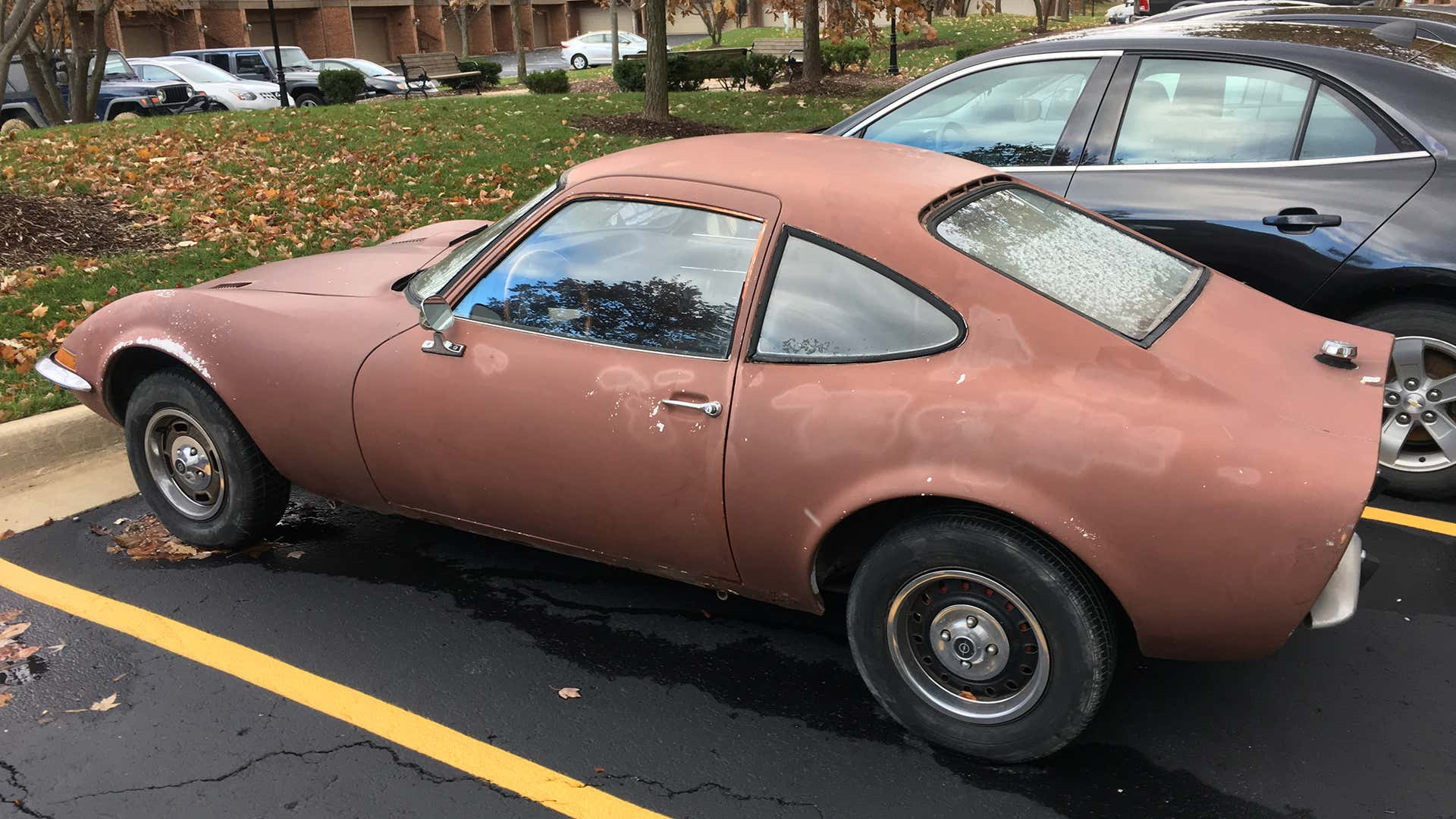 A 1970 Opel GT in a parking lot.