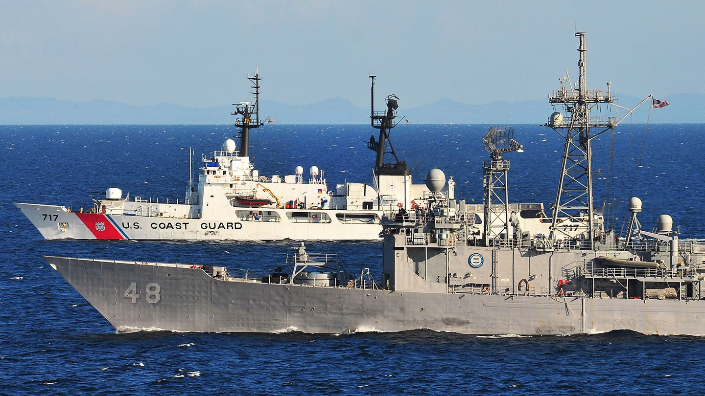 100528-N-7643B-241 .JAVA SEA (May 28, 2010) The guided-missile frigate USS Vandegrift (FFG 48) and the U.S. Coast Guard cutter Mellon (WHEC 717) transit side by side during a division tactics exercise as part of Naval Engagement Activity (NEA) Indonesia 2010. NEA is in its 16th year and is part of the Cooperation Afloat Readiness and Training (CARAT) series of bilateral exercises held annually in Southeast Asia to strengthen relationships and enhance force readiness. (U.S. Navy photo by Mass Communication Specialist 2nd Class David A. Brandenburg/Released).