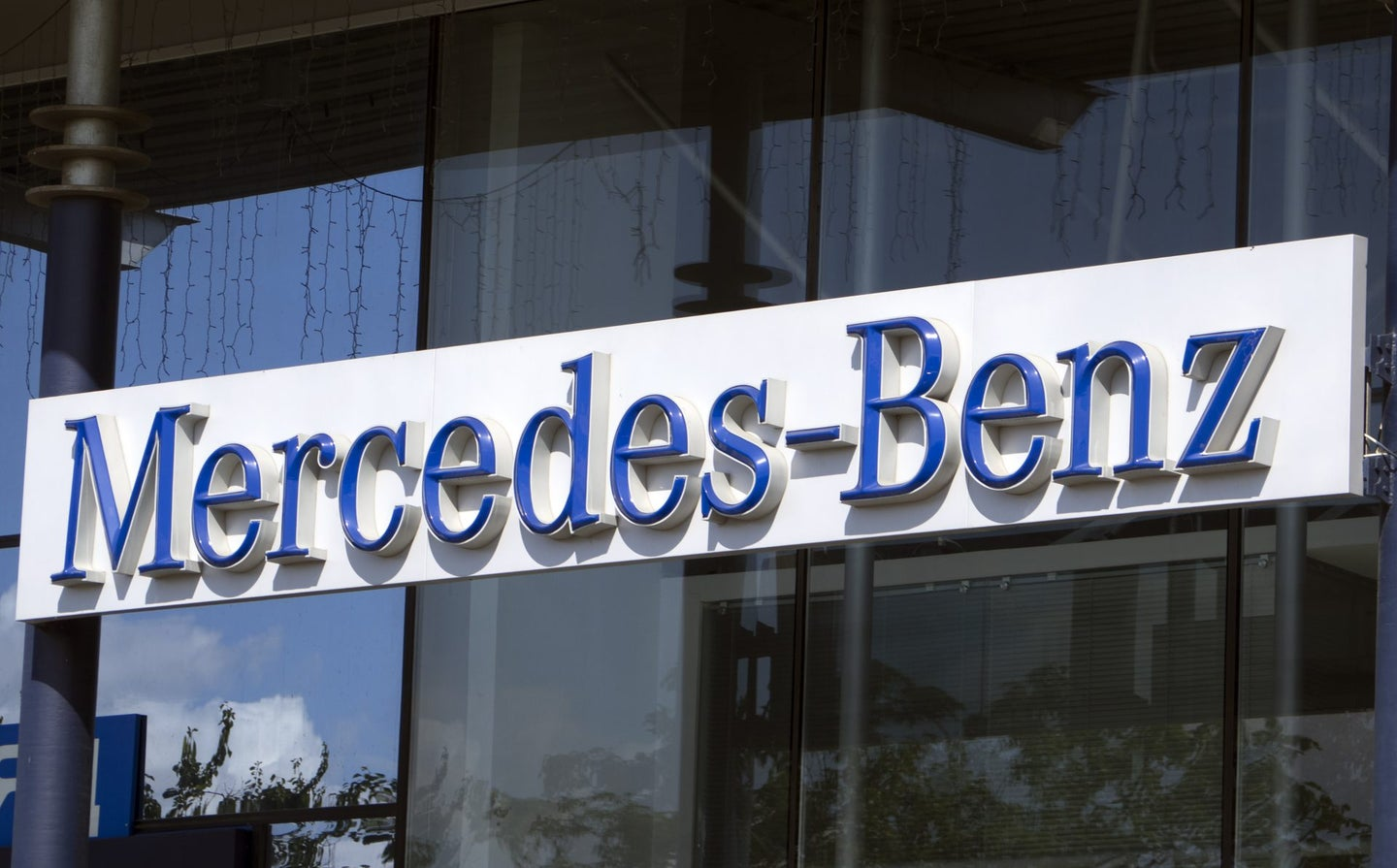 Mercedes-Benz sign. Mercedes-Benz is a division of Daimler