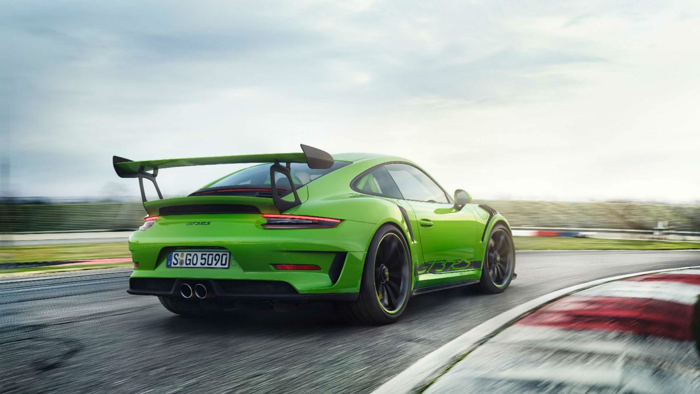 A lime-green Porsche 911 GT3 RS.
