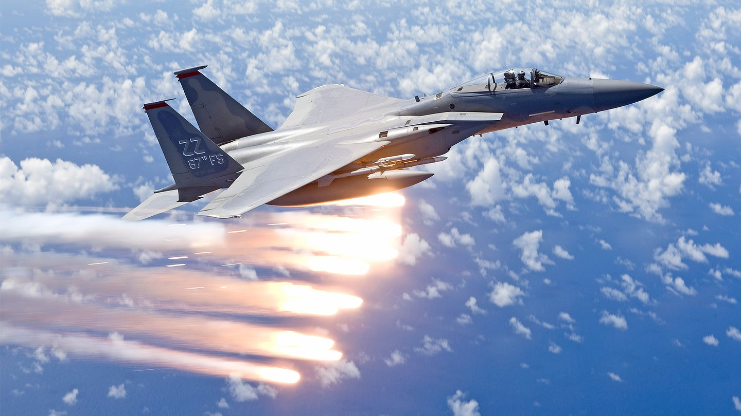 An F-15 Eagle from the 67th Fighter Squadron in Kadena Air Base, Okinawa, Japan, releases flares over the Pacific Ocean during a training mission.