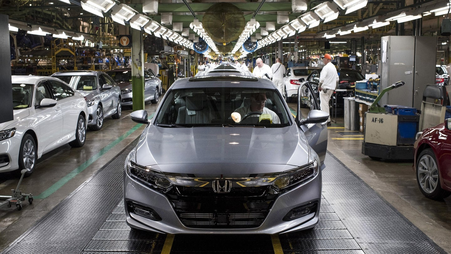 An employee prepares to drive a 2018 Honda Accord vehicle off the assembly line at the Honda of America Manufacturing Inc. Marysville Auto Plant in Marysville, Ohio, U.S., on Thursday, Dec. 21, 2017. More than three decades after Honda Motor Co. first built an Accord sedan at its Marysville factory in 1982, humans are still an integral part of the assembly process -- and that's unlikely to change anytime soon. Photographer: Ty Wright/Bloomberg