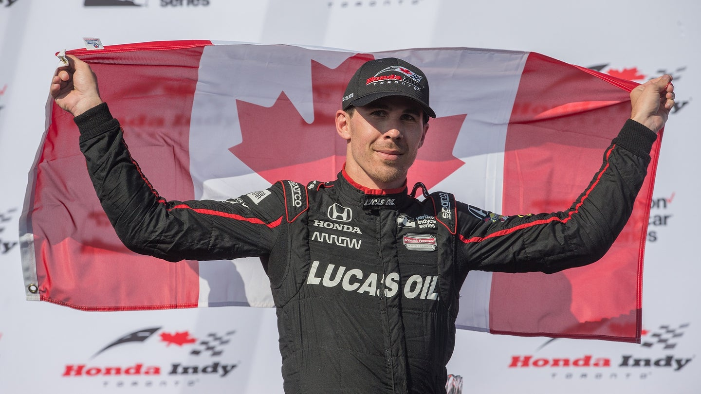 Scott Dixon, of New Zealand, takes the checkered flag at Honda Indy Toronto race