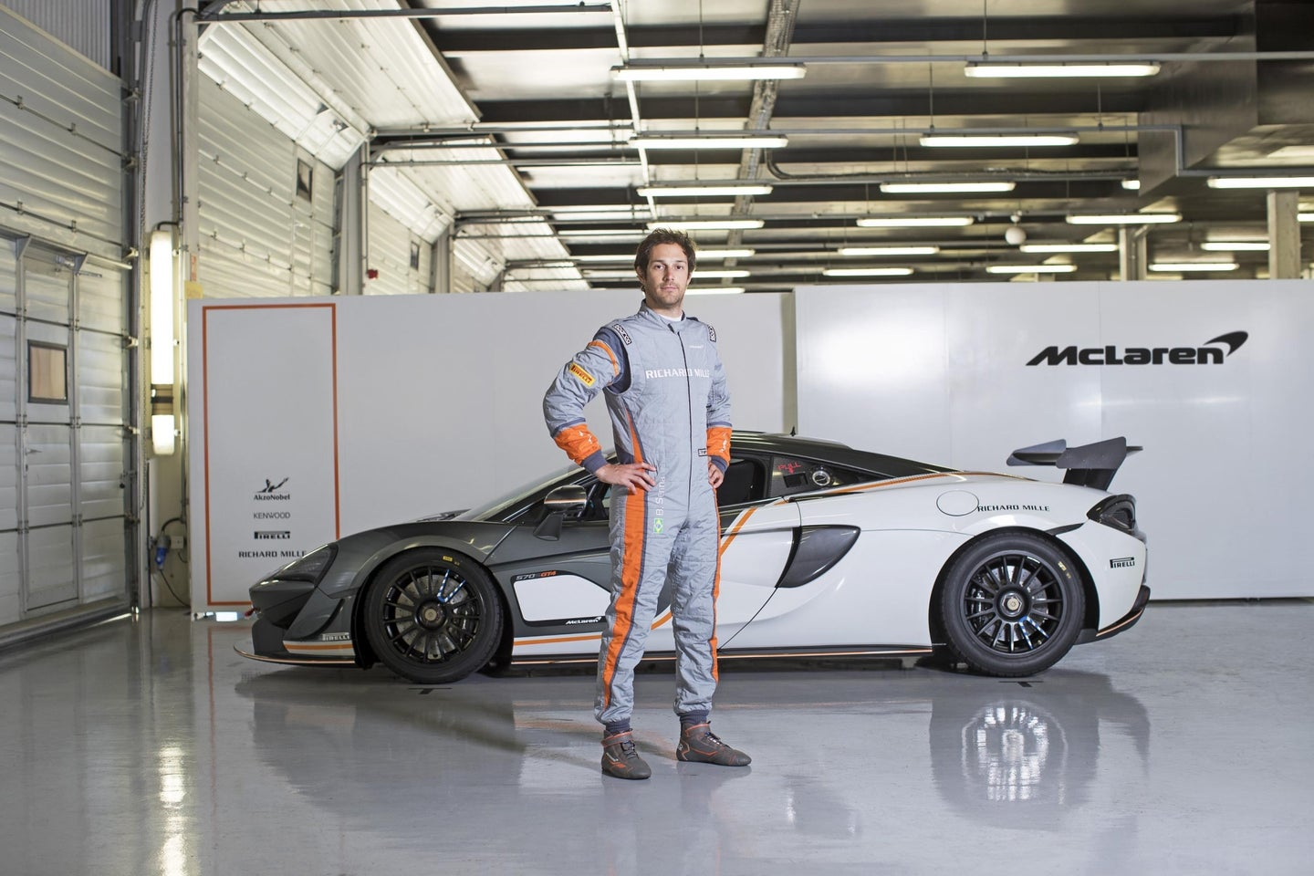 McLaren & Sparco Collaborate to Create World_s Lightest FIA-Certified Race Suit - Bruno Senna wears the SP16plus FIA race suit in front of the McLaren 570S GT4