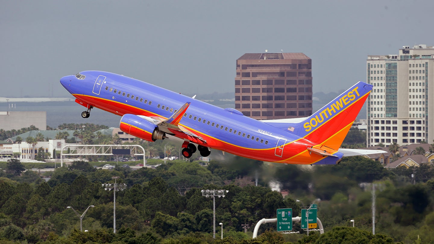 Southwest Boeing 737 wing scrap vomit sick wind