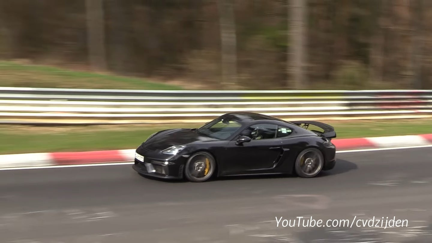 A 2020 Porsche 718 Cayman GT4 test mule makes its way around the Nurburgring Nordschleife.