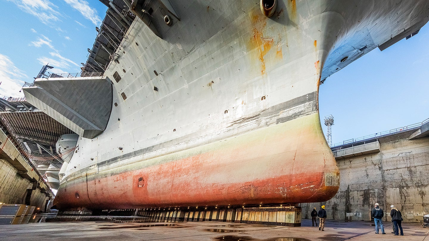 USS Nimitz (CVN 68) in  Dry Dock 6 post dewatering at Puget Sound Naval Shipyard & Intermediate Maintenance Facility.