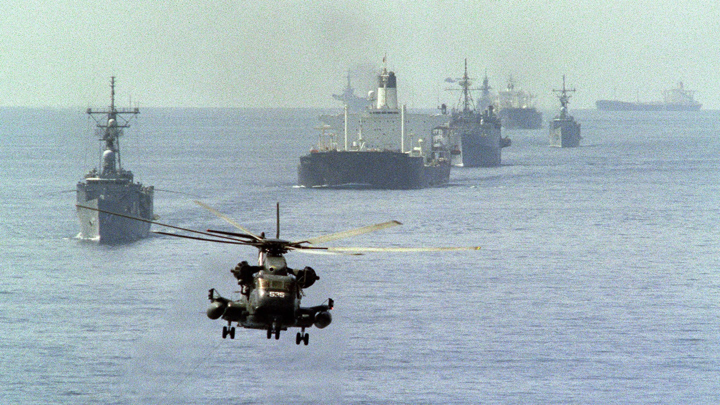 A US Navy minesweeping helicopter leads