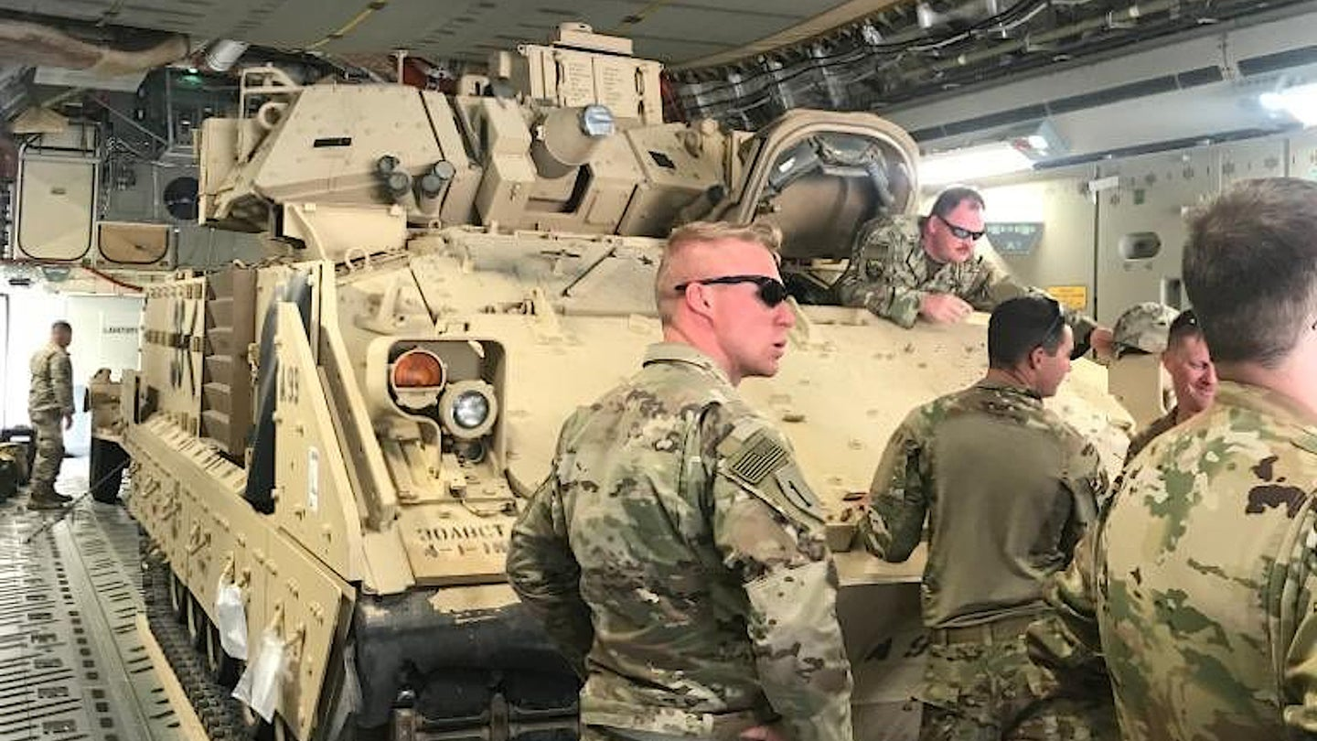 An M2A2 Bradley vehicle onboard a C-17 cargo plane headed to Syria in October 2019.