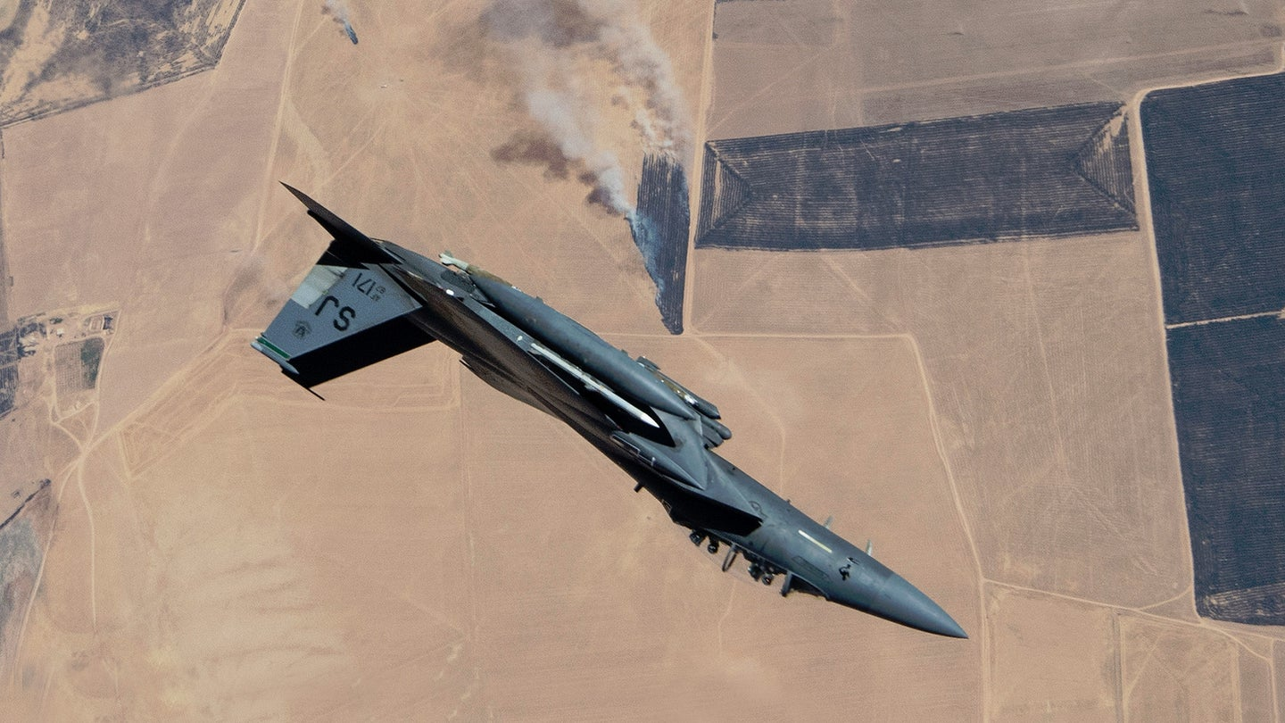 An F-15E rolls away after refueling somewhere in southwest Asia.