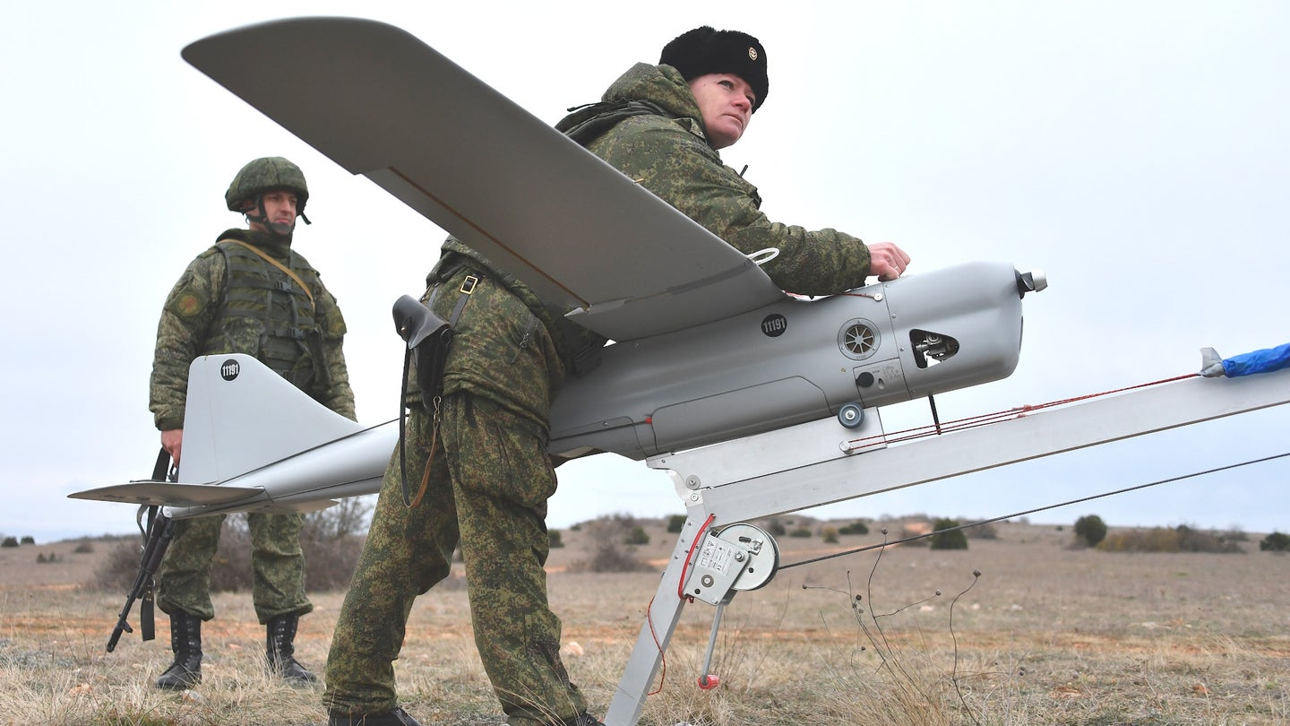 A member of the Russian Black Sea Fleet prepares to launch an Orlan-10 drone.