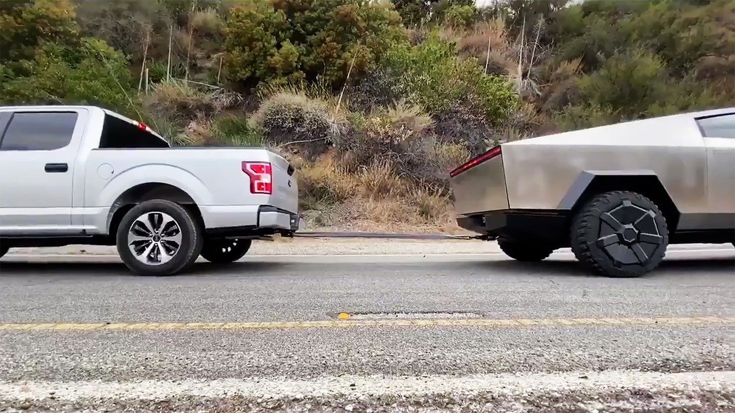 ford f150 tesla cybertruck tug of war