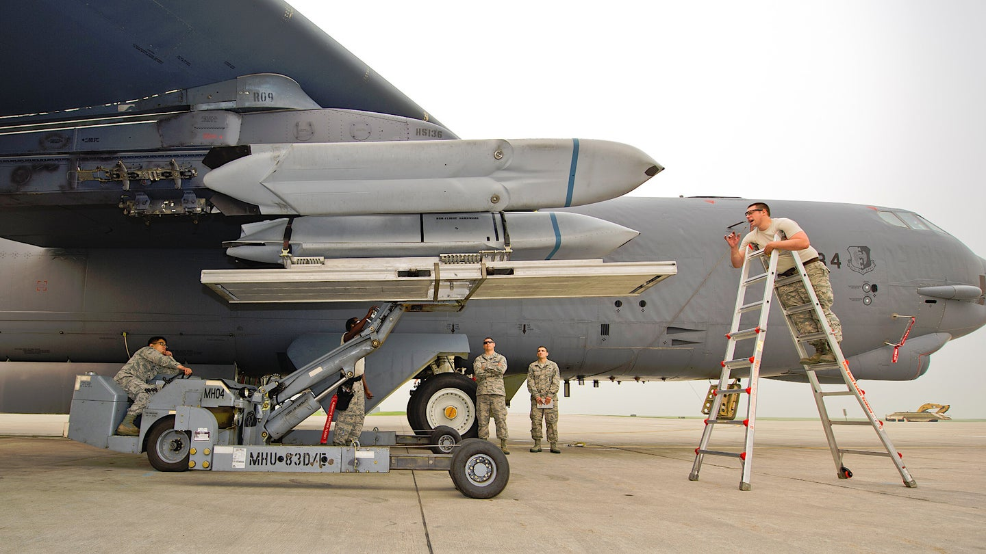 US Air Force personnel load AGM-158 JASSM cruise missiles onto a B-52 bomber