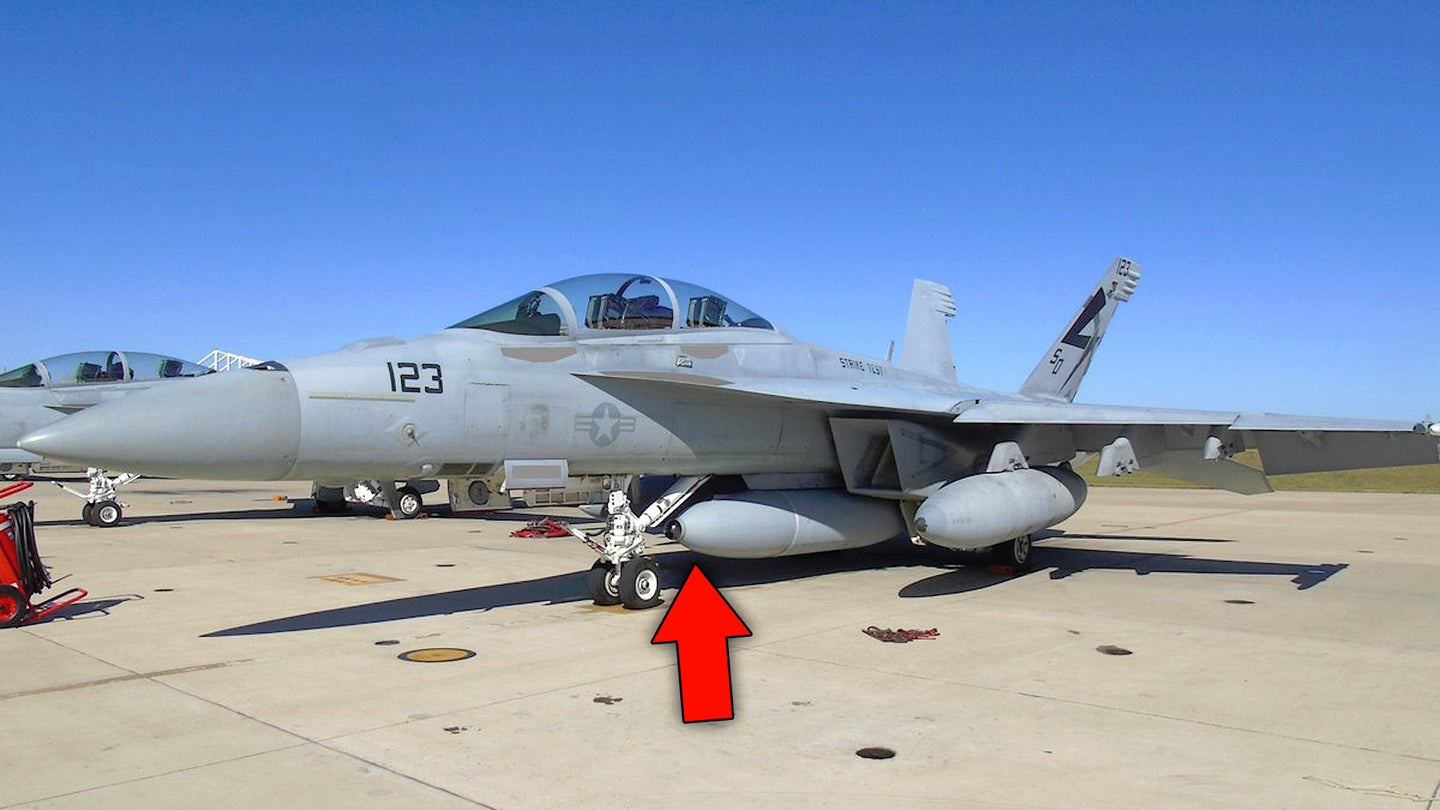 A Boeing F/A-18F Super Hornet with a podded infrared search and track system.