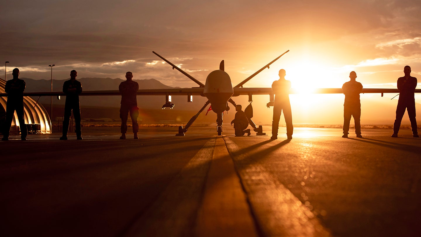 MQ-9 Reaper and aircrew underneath Nevada sunset