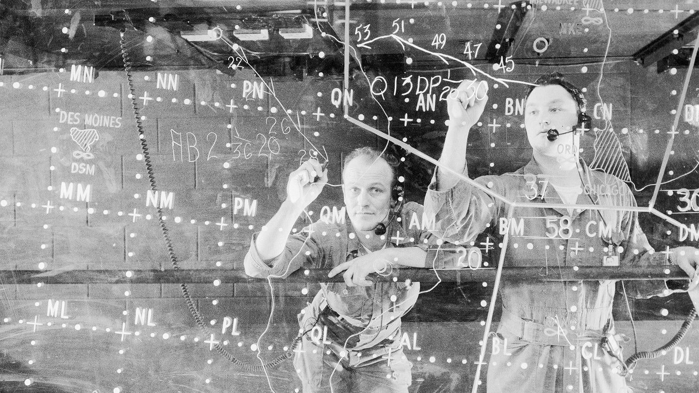 Soldiers Write Aircraft Movements on Plotting Board