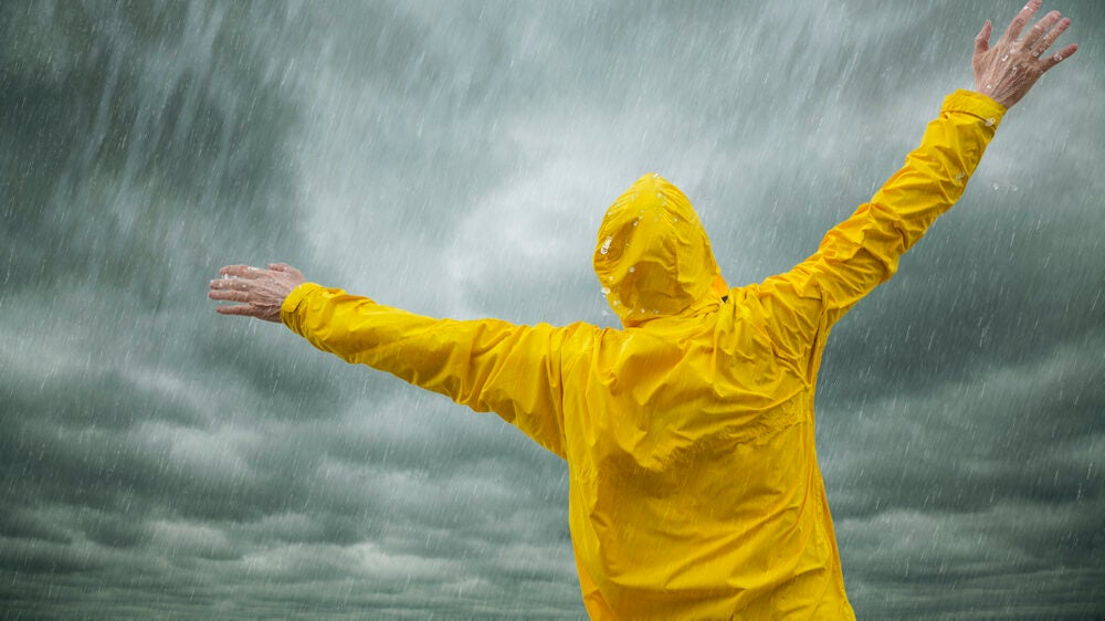 Man With Yellow Best Rain Jacket