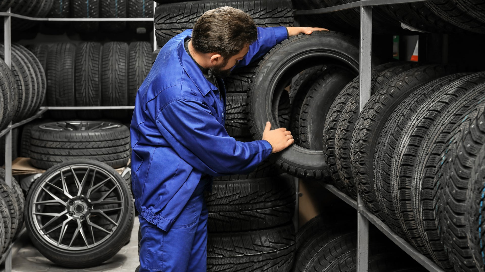 Man inspecting tires