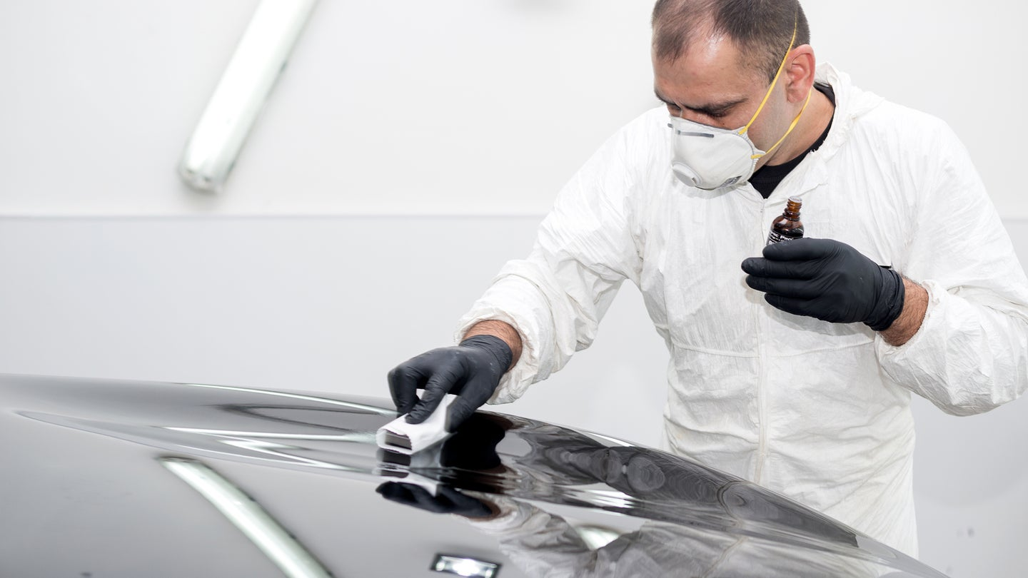 Applying a protective ceramic coating to the surface of a car